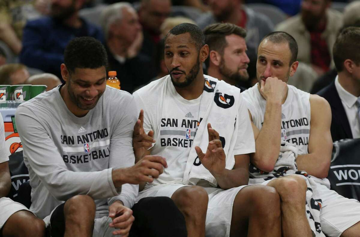 San Antonio Spurs' Boris Diaw, center, talks with Tim Duncan, left, and Manu Ginobili during the second half against the Utah Jazz at the AT&T Center, Wednesday, Jan. 6, 2016. The Spurs won, 123-98.