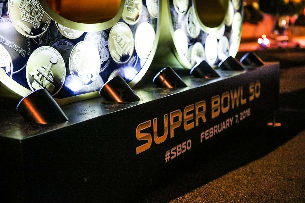 """The base of a large sculpture reads, """"Super Bowl 50"""", as it lights up a six-foot sculpture that sits in Alamo Square Park, in San Francisco, California on Friday, January 15, 2016."""