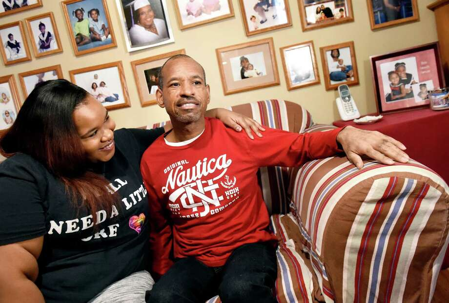 "Alexandria Coleman, 21, left, with her father, Markus Coleman, who has Huntington's disease, on Tuesday, Jan. 12, 2016, at their home in Albany, N.Y. A movie theater manager recently threatened to kick him out of the theatre unless he ""controlled himself."" (Cindy Schultz / Times Union) Photo: Cindy Schultz / 10034954A"