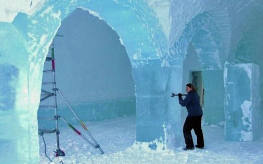 Greenwich designer Mary Gibbons is shown at work on the Icehotel in Sweden. Every year the tourist facility melts and is rebuilt. Photo: Contributed Photos / Greenwich Time Contributed