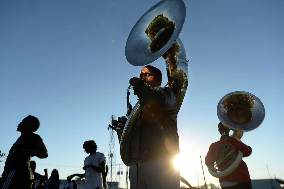 Central High School's marching band, including tuba player Tigee Mitchell, 15, gets in a final practice as the sun sets Friday. Tomorrow, they will perform in the MLK parade through Beaumont, and that night will compete in the 2nd Annual Battle of the Bands at Port Arthur Memorial's stadium. The event begins at 6 p.m. and features bands from Southeast Texas and Louisiana competing for a regional win.  Photo taken Friday, January 15, 2016  Kim Brent/The Enterprise Photo: Kim Brent / Beaumont Enterprise