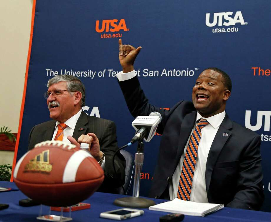 "New UTSA football coach Frank Wilson and President Richard Romo are given instruction by football players in back to learn the proper way to give ""Birds Up"". New UTSA football coach Frank Wilson, formerly the running backs coach and recruiting coordinator for LSU. UTSA present Ricardo Romo and athletic director Lynn Hickey will be in attendance on Friday, January 15, 2016 at H.E.B. University Center. Photo: Ronald Cortes, Freelance / For The Express And / For the Express and News"