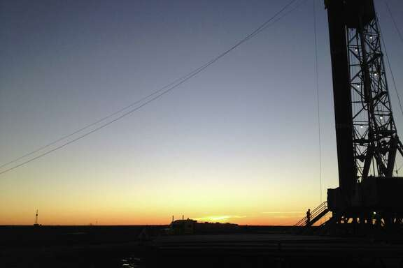 The setting sun silhouettes Parsley Energyé­s Dusek 45-IH, the companyé­s first horizontal well in West Texasé­ Permian Basin, which it drilled in 2013. (Parsley Energy photo)