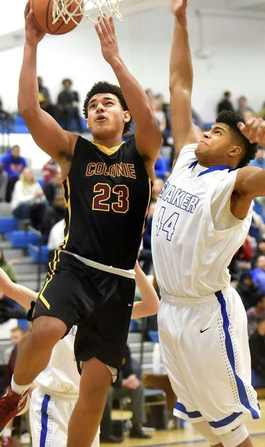 Colonie's Isaiah Moll, left, goes to the hoop as Shaker's Brandon Barlow defends during their basketball game on Friday, Jan. 15, 2016, at Shaker High in Latham, N.Y. (Cindy Schultz / Times Union) Photo: Cindy Schultz / 10035002A