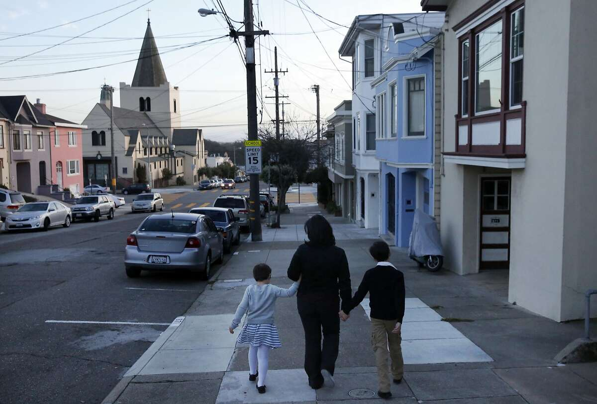 Marjan Philhour walks to the store with two of her three children Sophie, 6, left, and Joey, 8, after canvassing their neighborhood after school Jan. 15, 2015 in San Francisco, Calif. Philhour is running for District 1 Supervisor in San Francisco. She often canvasses her neighborhood with the help of one or all of her three children.