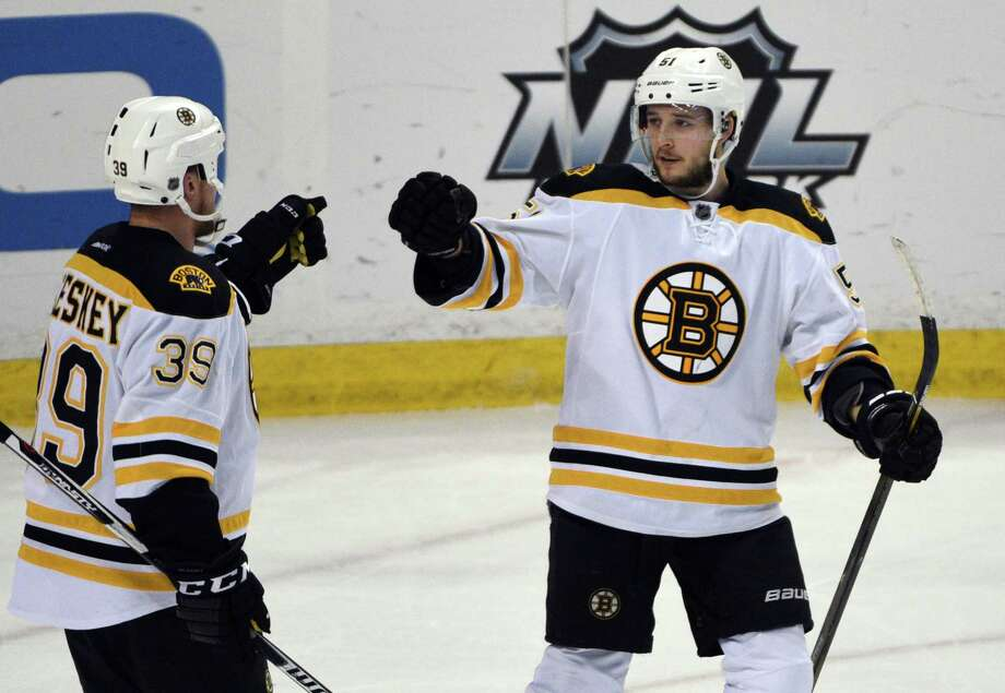 Boston Bruins left winger Matt Beleskey (39) celebrates with center Ryan Spooner (51) after Spooner scored during the third period of an NHL hockey game against the Buffalo Sabres, Friday, Jan. 15, 2016 in Buffalo, N.Y. Boston won 4-1. (AP Photo/Gary Wiepert) ORG XMIT: NYGW107 Photo: Gary Wiepert / FR170498 AP