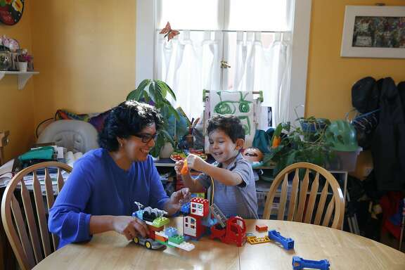 Kimberly Alvarenga plays with her son Oziah Alvarenga Haynes, 3, at their kitchen table in her home Jan. 15, 2015 in San Francisco, Calif. Alvarenga is running for the District 11 supervisor seat.