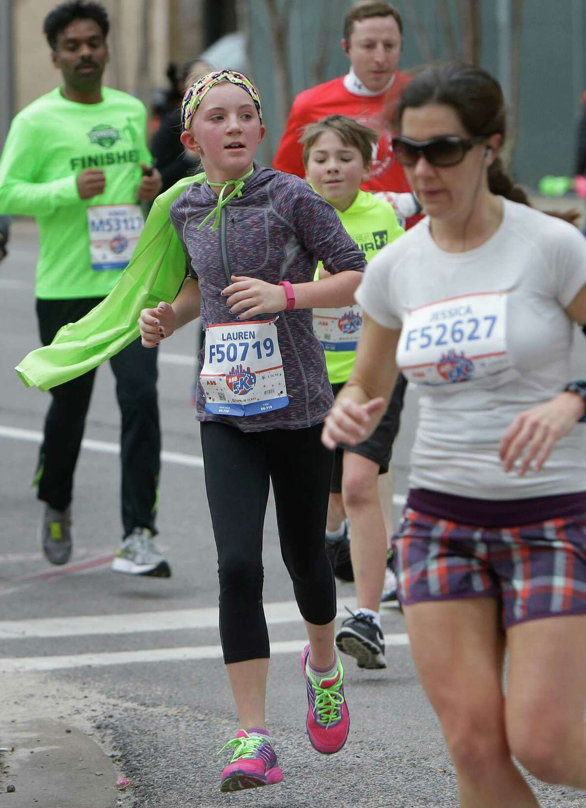 People participate in the ABB 5K in downtown Houston Saturday, Jan. 16, 2016.