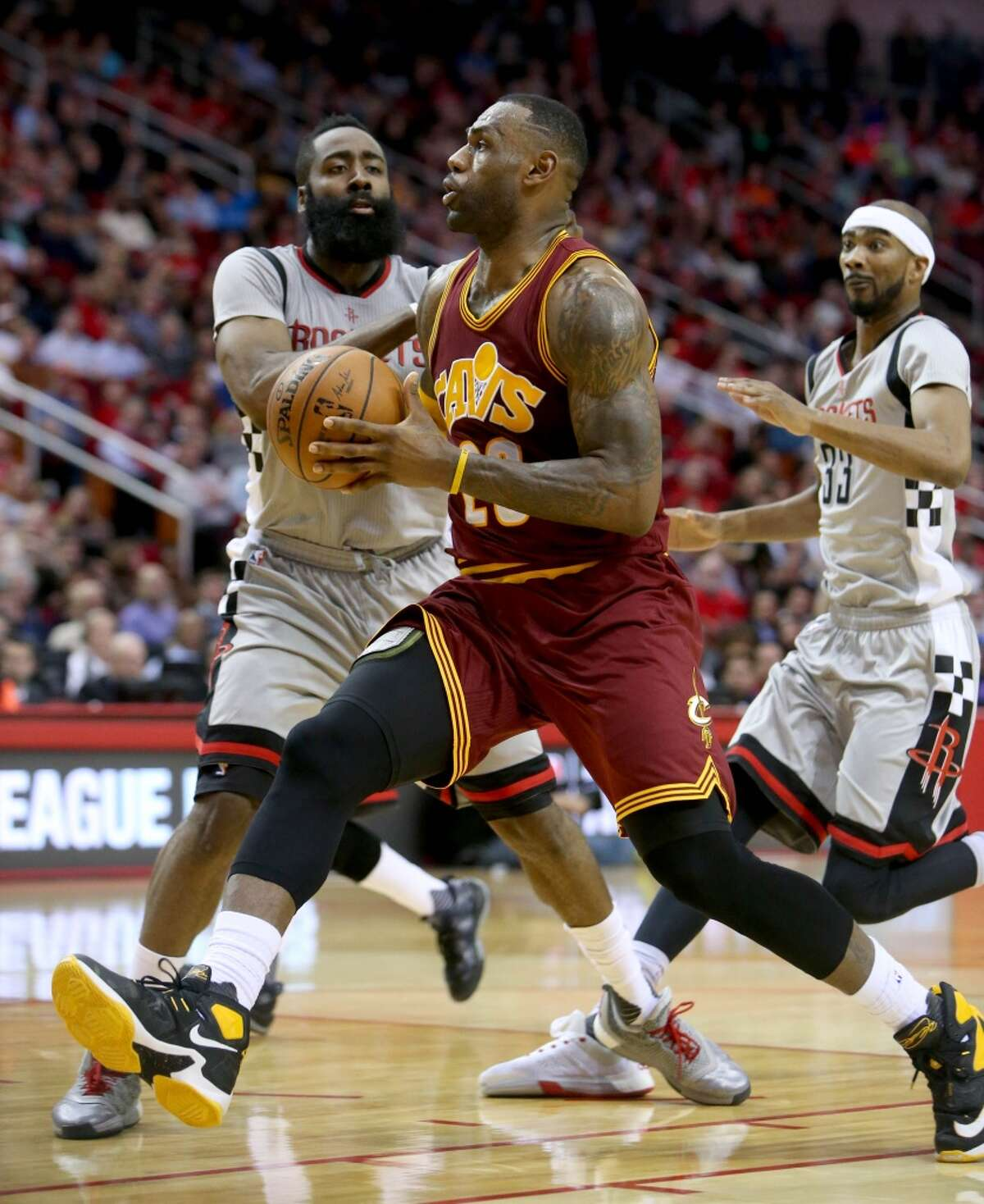 Cleveland Cavaliers forward LeBron James (23) drives around Houston Rockets guard James Harden (13) scoring in the third quarter at the Toyota Center Friday, Jan. 15, 2016, in Houston. Rockets lost 77-91. ( Gary Coronado / Houston Chronicle )