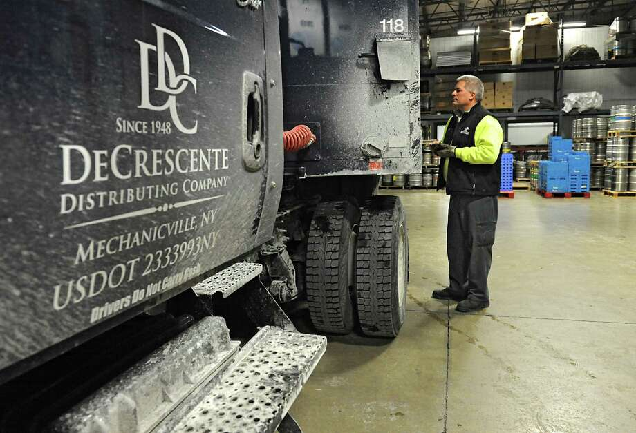 Jeff Ramnes, assistant reconciliation manager, reconciles the load on a returning delivery truck at DeCrescente Distributing Company on North Main St. Thursday Jan. 14, 2016 in Mechanicville, N.Y. DeCrescente is recruiting for summer job openings, (Lori Van Buren / Times Union) Photo: Lori Van Buren / 10034996A