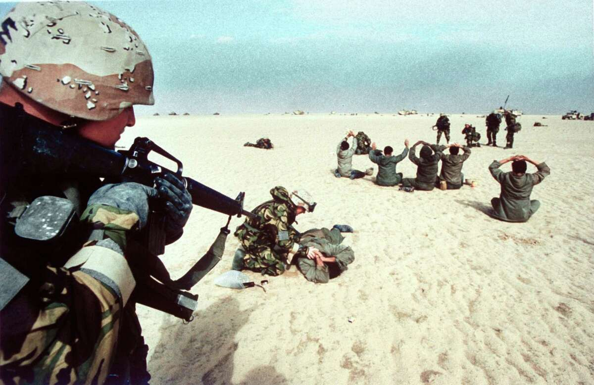 Feb. 25, 1991: American troops guard Iraqi prisoners of war during the ground campaign of Operation Desert Storm.