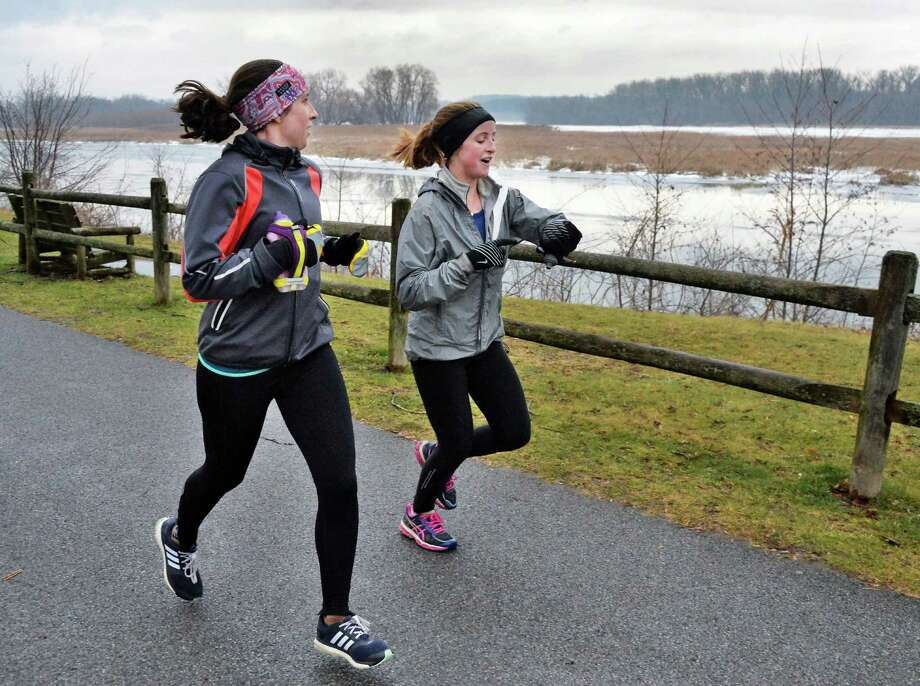Morgan Feder, left, and Meghan Heneghan, both of Washington DC, finish up a 20-mile run along the Mohawk River Saturday Jan. 16, 2016 in Niskayuna, NY. Here visiting Feder's family in Ballston Spa, the running partners took advantage of the unseasonably warm weather to train for an upcoming marathon in Myrtle Beach.    (John Carl D'Annibale / Times Union) Photo: John Carl D'Annibale