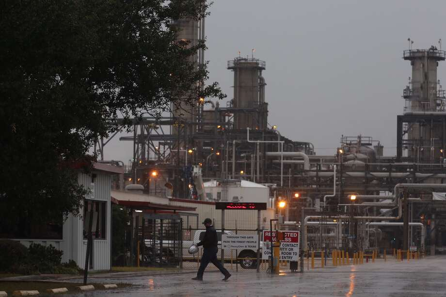 A man walks by the gate of a PeroxyChem plant in the 12000 block of Bay Area Blvd, in the Bayport complex, Saturday Jan. 16, 2016, in Pasadena. One person was killed and three were injured in a chemical explosion or leak, according to authorities. Photo: Houston Chronicle
