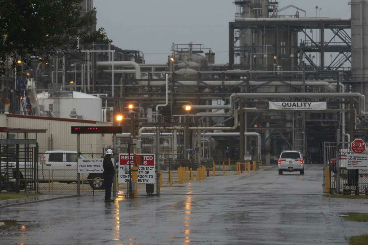 A man watches an emergency services vehicle enter a PeroxyChem plant in the 12000 block of Bay Area Blvd, in the Bayport complex, Saturday Jan. 16, 2016, in Pasadena. One person was killed and three were injured in a chemical explosion or leak, according to authorities.