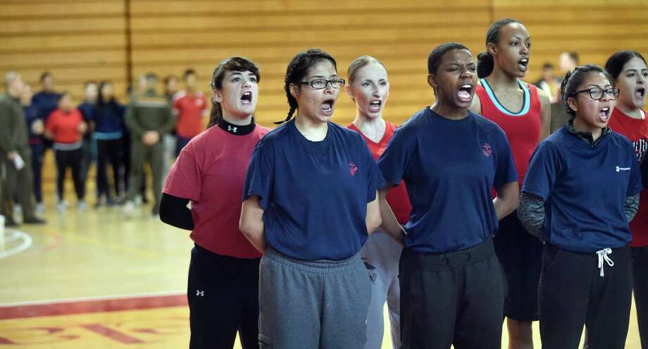 Brittany Alexander, 19, of Albany, third from right, joins fellow enlistees as they recite Marine Corps structure and basic knowledge during physical training on Saturday, Jan. 16, 2016, at Rensselaer Polytechnic Institute in Troy, N.Y. Female enlistees ages 17-24, including three from the Capital Region, tested their strength and endurance in preparation for boot camp. (Cindy Schultz / Times Union) Photo: Cindy Schultz / 10035022A