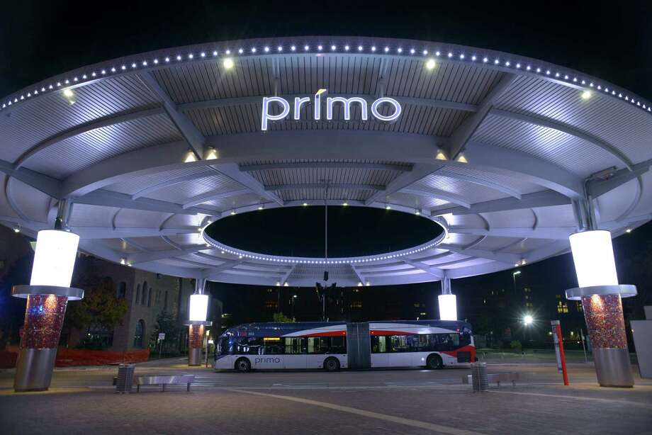 A VIA Primo bus arrives beneath the Primo awning at VIA's Centro Plaza, at West Houston Street and Frio Street, in early December. With the route changes that started Monday, nine more VIA lines go through Centro, its West Side hub. Photo: Billy Calzada /San Antonio Express-News / San Antonio Express-News