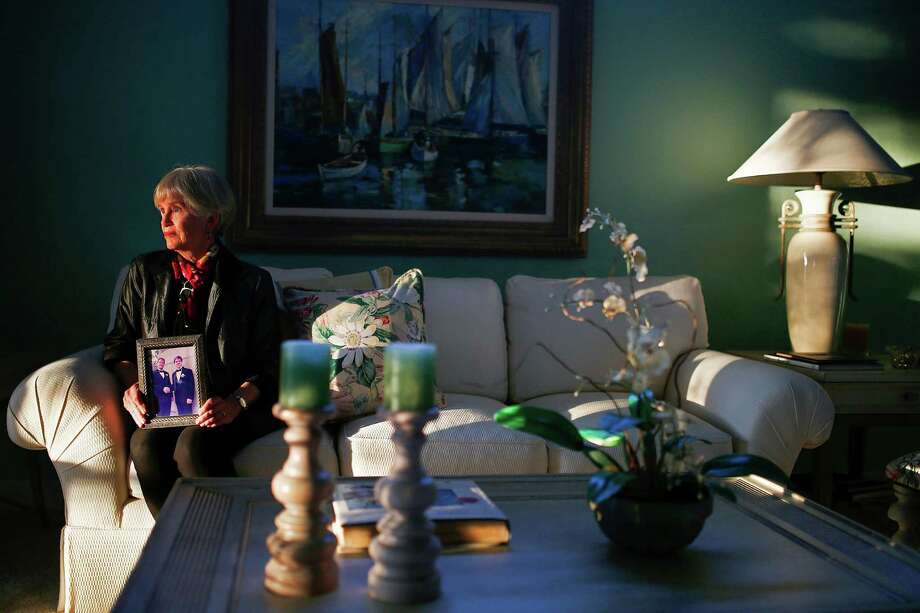 Judy Rummler holds a photograph of her son, who took OxyContin prescribed for a back injury, became addicted and later died of a heroin overdose, at home in Bonita Springs, Fla., Nov. 10, 2015. Drug overdoses are contributing to rising death rates for young adult whites, which have reached a level not seen since the end of the AIDS epidemic. (Corey Perrine/The New York Times) ORG XMIT: XNYT36 Photo: COREY PERRINE / NYTNS