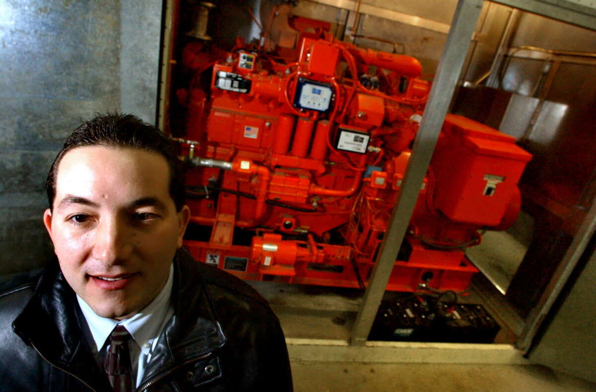 Times Union archive photo-- Steve Diraimo, account executive of Siemens, poses by one of three internal combustion gas engines at Maplewood Manor Tuesday, Dec. 31, 2002, in Ballston Spa, N.Y. (Cindy Schultz/Times Union)
