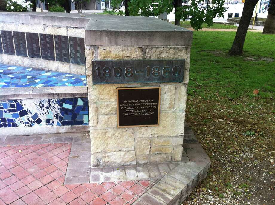"""The Milam Park markers — a series of granite plaques — """"pay tribute to those individuals who helped to pioneer the area and whose names were taken from the San Fernando Cathedral Records as those officially buried in the cemetery."""" Photo: Martin Briseno /Courtesy"""