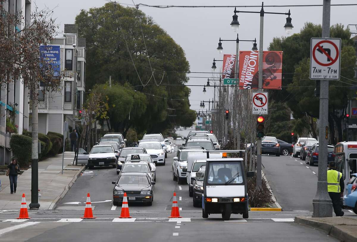 Northbound traffic on Divisadero Street is detoured at Geary Street while police officers investigate a fatal accident involving a tour bus a pedestrian one block away at Post and Divisadero streets in San Francisco, Calif. on Saturday, Jan. 16, 2016.
