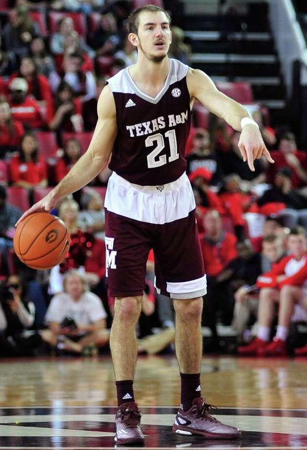 Texas A&M guard Alex Caruso (21) calls out to teammates during an NCAA college basketball game against Georgia Saturday, Jan. 16, 2016, in Athens, Ga. (AP Photo/Richard Hamm) Photo: Richard Hamm, FRE / Associated Press / FR470785 AP