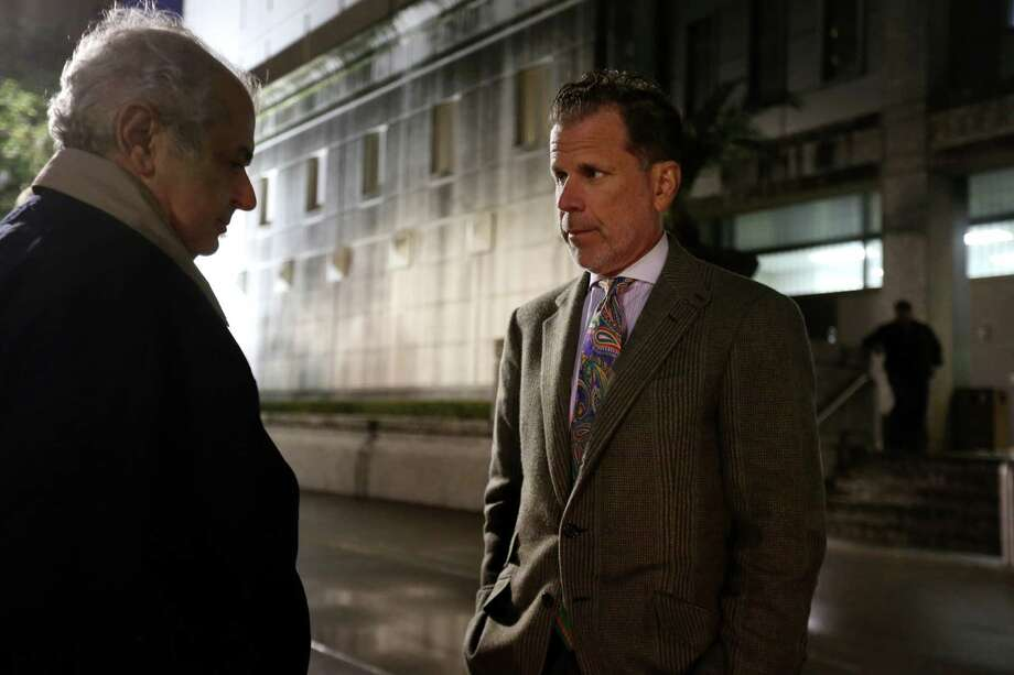 Joel Androphy, right, attorney for Baghram Mechanic, shown with a friend of Mechanic, waits out front for his client to be released from the Federal Detention Center Saturday, Jan. 16, 2016, in Houston. Baghram is one of 7 people pardoned by Obama as part of swap with Iran. Photo: Gary Coronado, Houston Chronicle / © 2015 Houston Chronicle