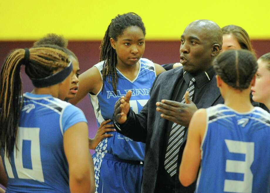 Albany head coach Decky Lawson instructs his players against Troy during the first half of their girls' high school basketball game on Thursday, Dec. 17, 2015, in Troy, N.Y. (Hans Pennink / Special to the Times Union) ORG XMIT: HP110 Photo: Hans Pennink / 10034669A