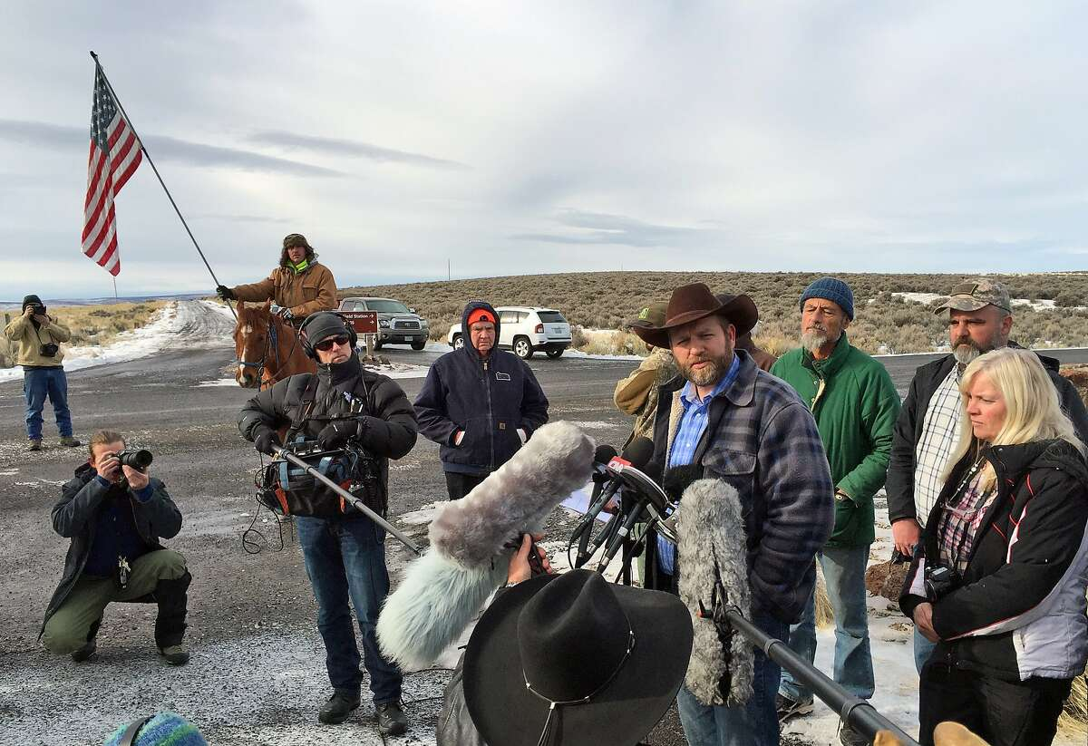 Ammon Bundy speaks to reporters at the Malheur National Wildlife Refuge in Burns, Ore., on Thursday, Jan. 14, 2016. Bundy is the leader of a small, armed group that has been occupying the remote refuge in Oregon since Jan. 2 to protest federal land policies. (AP Photo/Keith Ridler)
