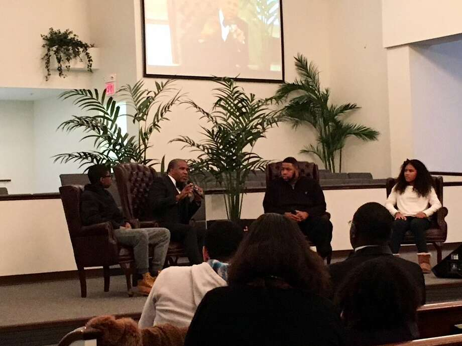 Billionaire investor Robert F. Smith, center left, and Senior Pastor Reverend Damone Paul Johnson, center right, sat with two children on Saturday afternoon to answer questions on business, faith and success.