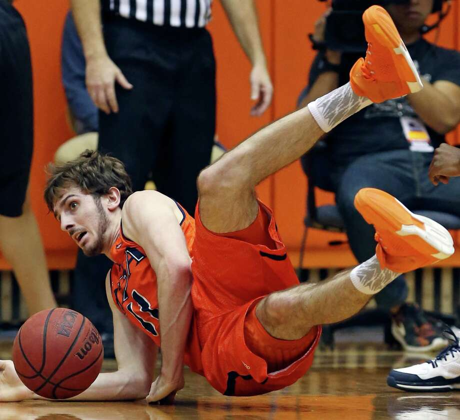 UTSA's Austin Karrer dives for a loose ball during second half action against UTEP Saturday Jan. 16, 2016 at the Convocation Center. UTSA won 71-67. Photo: Edward A. Ornelas, Staff / San Antonio Express-News / © 2016 San Antonio Express-News