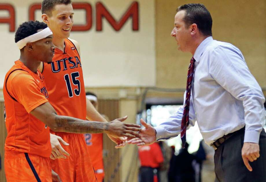 UTSA's Christian Wilson (from left) and Lucas O'Brien celebrate with head coach Brooks Thompson late in the game with UTEP on Jan. 16, 2016 at the Convocation Center. UTSA won 71-67. Photo: Edward A. Ornelas /San Antonio Express-News / © 2016 San Antonio Express-News