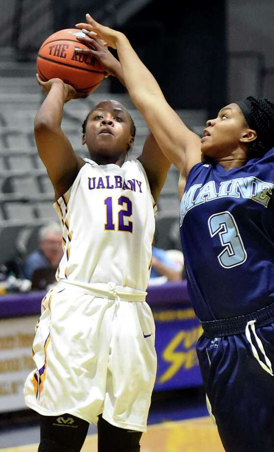 UAlbany's Imani Tate, left, shoots for the hoop as Maine's Chantel Charles defends during their basketball game on Saturday, Jan. 16, 2016, at SEFCU Arena in Albany, N.Y. (Cindy Schultz / Times Union) Photo: Cindy Schultz / 10035015A