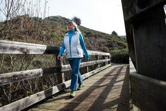 Kristin Shannon, the chairman of the Mountain Tamalpais task force, hikes across a footbridge at the end of Diaz Ridge trail, in Marin County, California, on Friday, January 15, 2016.