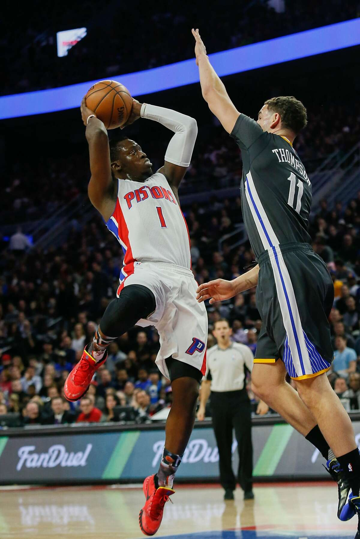 The Detroit Pistons' Reggie Jackson shoots against the Golden State Warriors' Klay Thompson during the first quarter at the Palace of Auburn Hills on Saturday, Jan. 16, 2016, in Auburn Hills, Mich. (Kimberly P. Mitchell/Detroit Free Press/TNS)
