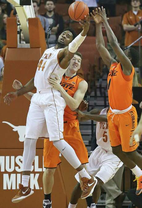 Ut center Prince Ibeh stretches to grab an offensive rebound away from Jawun Evans as Texas hosts Oklahoma State at the Erwin Center in Austin on January 16, 2016. Photo: TOM REEL, STAFF / SAN ANTONIO EXPRESS-NEWS / 2016 SAN ANTONIO EXPRESS-NEWS