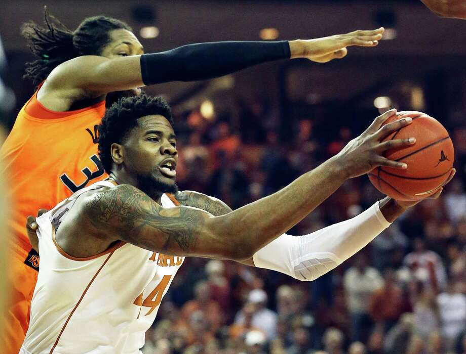 UT center Prince Ibeh grabs a defensive rebound in front of Anthony Allen as Texas hosts Oklahoma State at the Erwin Center in Austin on January 16, 2016. Photo: TOM REEL, STAFF / SAN ANTONIO EXPRESS-NEWS / 2016 SAN ANTONIO EXPRESS-NEWS