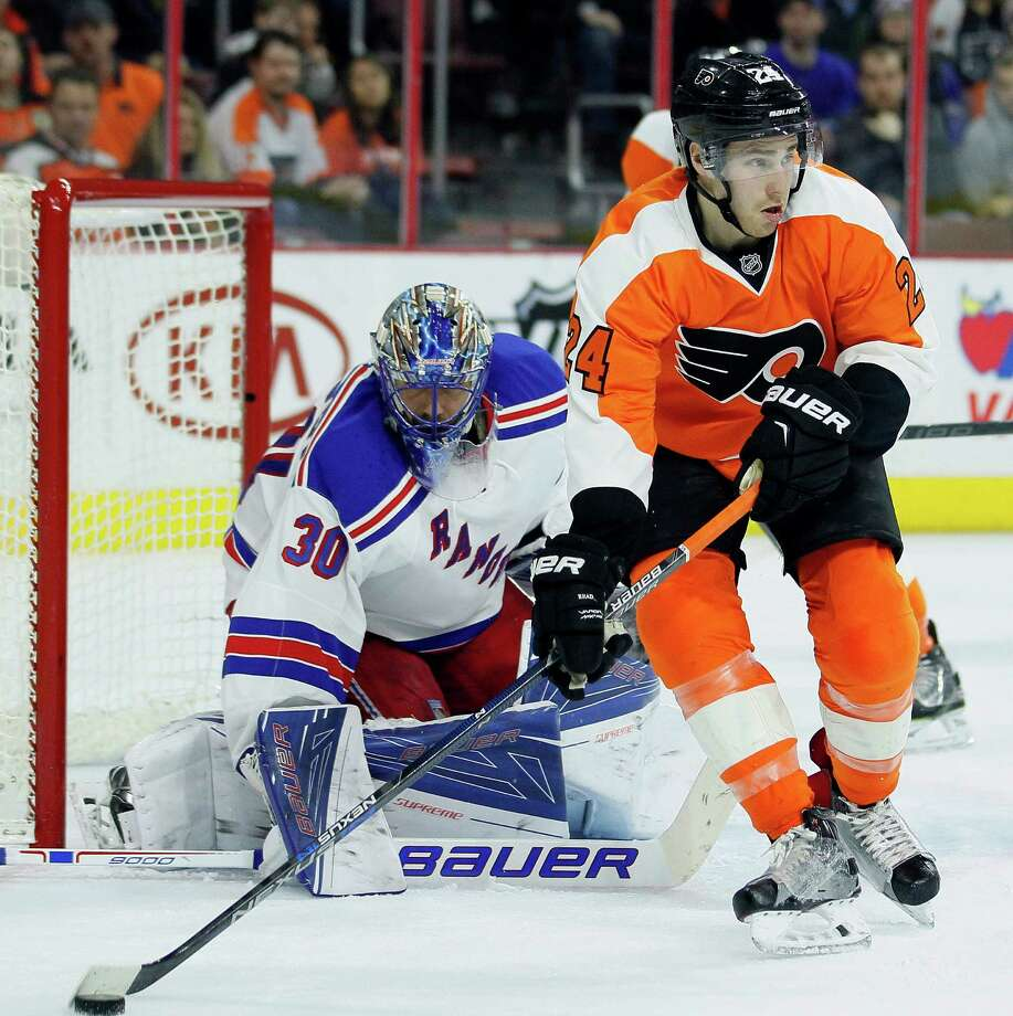 Philadelphia Flyers' Matt Read, with the puck on his stick, looks for an open man in front of the net defended by New York Rangers' Henrik Lundqvist during the second period of an NHL hockey game Saturday, Jan 16, 2016 in Philadelphia. The Rangers won 3-2 in overtime (AP Photo /Tom Mihalek)  ORG XMIT: PATM111 Photo: Tom Mihalek / FR148949 AP