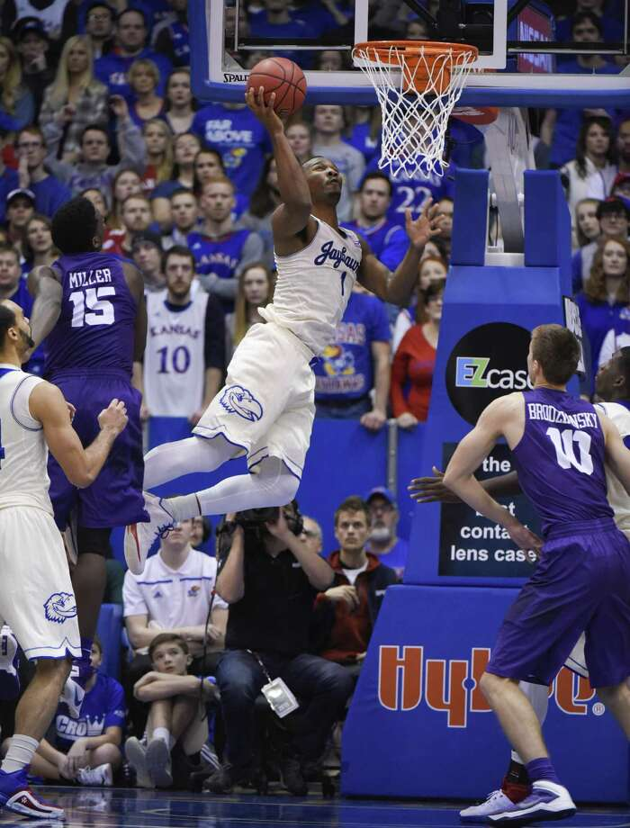 LAWRENCE, KS - JANUARY 16:  Wayne Selden Jr. #1 of the Kansas Jayhawks goes up for a shot against JD Miller #15 of the TCU Horned Frogs in the second half at Allen Fieldhouse on January 16, 2016 in Lawrence, Kansas. (Photo by Ed Zurga/Getty Images) ORG XMIT: 587451601 Photo: Ed Zurga / 2016 Getty Images