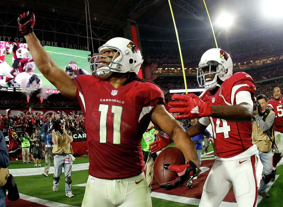 GLENDALE, AZ - JANUARY 16: Wide receiver Larry Fitzgerald #11 of the Arizona Cardinals celebrates his game winning touchdown in overtime with wide receiver J.J. Nelson #14 (right) during the NFC Divisional Playoff Game at University of Phoenix Stadium on January 16, 2016 in Glendale, Arizona. The Arizona Cardinals beat the Green Bay Packers 26-20. (Photo by Christian Petersen/Getty Images) ORG XMIT: 599402223 Photo: Christian Petersen / 2016 Getty Images