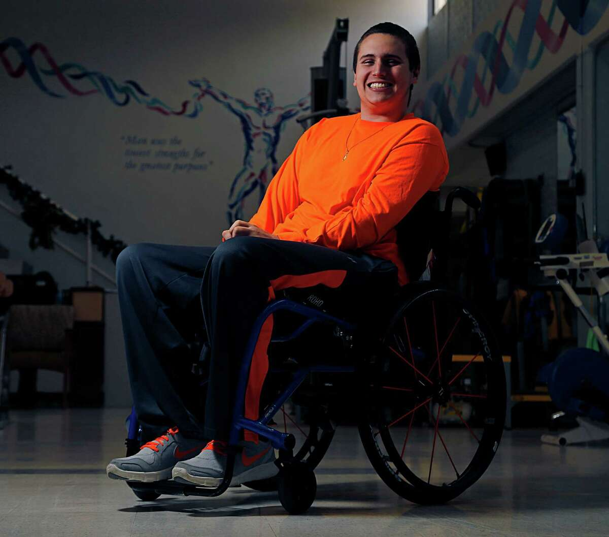 Louis Tontodonato, 20, who broke his neck in a car accident a year ago poses for a portrait at TIRR Memorial Hermann after test Wednesday, Dec. 16, 2015, in Houston.