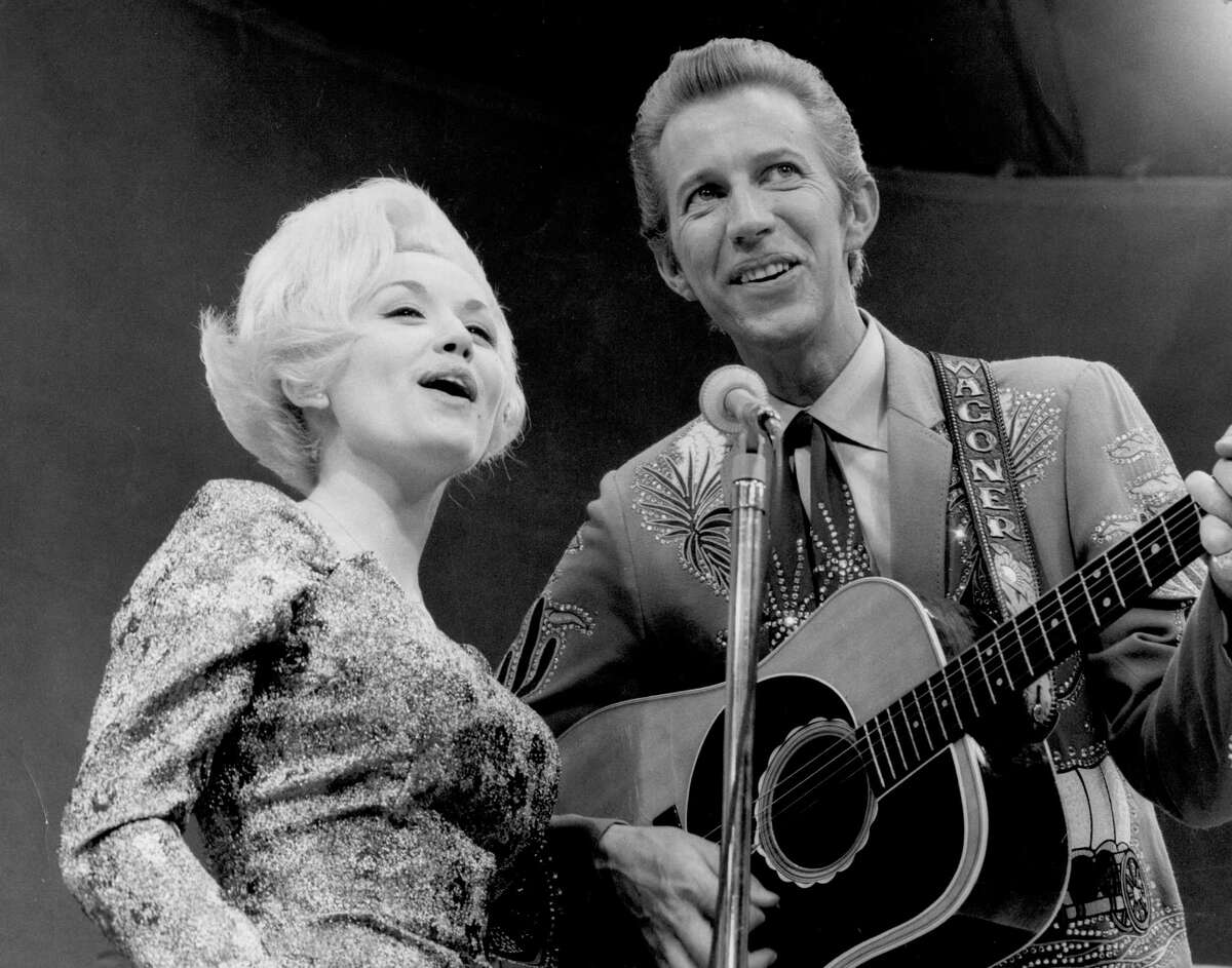 1970: With crooner Porter Wagoner, a huge star at the time; their collaboration rocketed her to stardom
