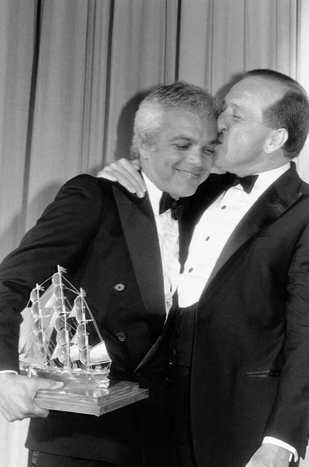 "Designer Ralph Lauren gets a kiss from Career Achievement Award presenter Wilkes Bashford during Cutty Sark Fashion Awards ceremonies in Philadelphia, June 21, 1983. Lauren received the award for ""continuing leadership and outstanding contributions to men's fashions."" Bashford was last year's recipient of a Cutty Sark award for creative retailing. The winners are selected by a panel of U.S. fashion writers. (AP Photo/George Widman) Photo: George Widman / AP / AP"