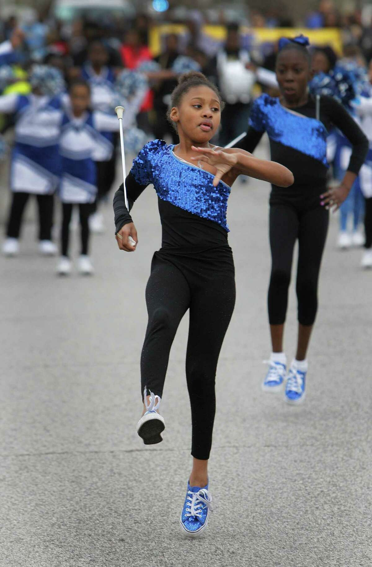 Kenadi Walker leads the Mading Elementary cheerleaders in the 2016 Black Heritage Society's MLK Children's March Saturday, Jan. 16, 2016, in Houston. The march started and circled MacGregor Park.