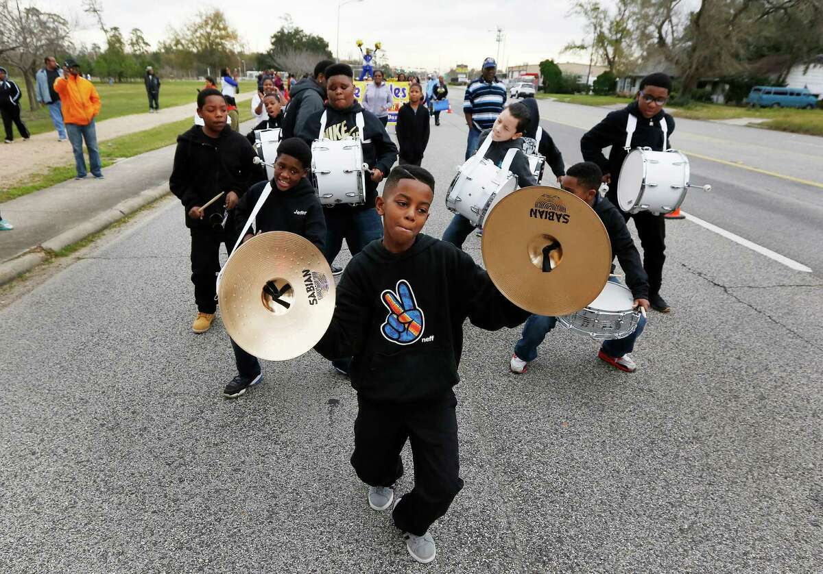 James Williams leads the Mading Elementary Drumline in the 2016 Black Heritage Society's MLK Children's March Saturday, Jan. 16, 2016, in Houston. The march started and circled MacGregor Park.