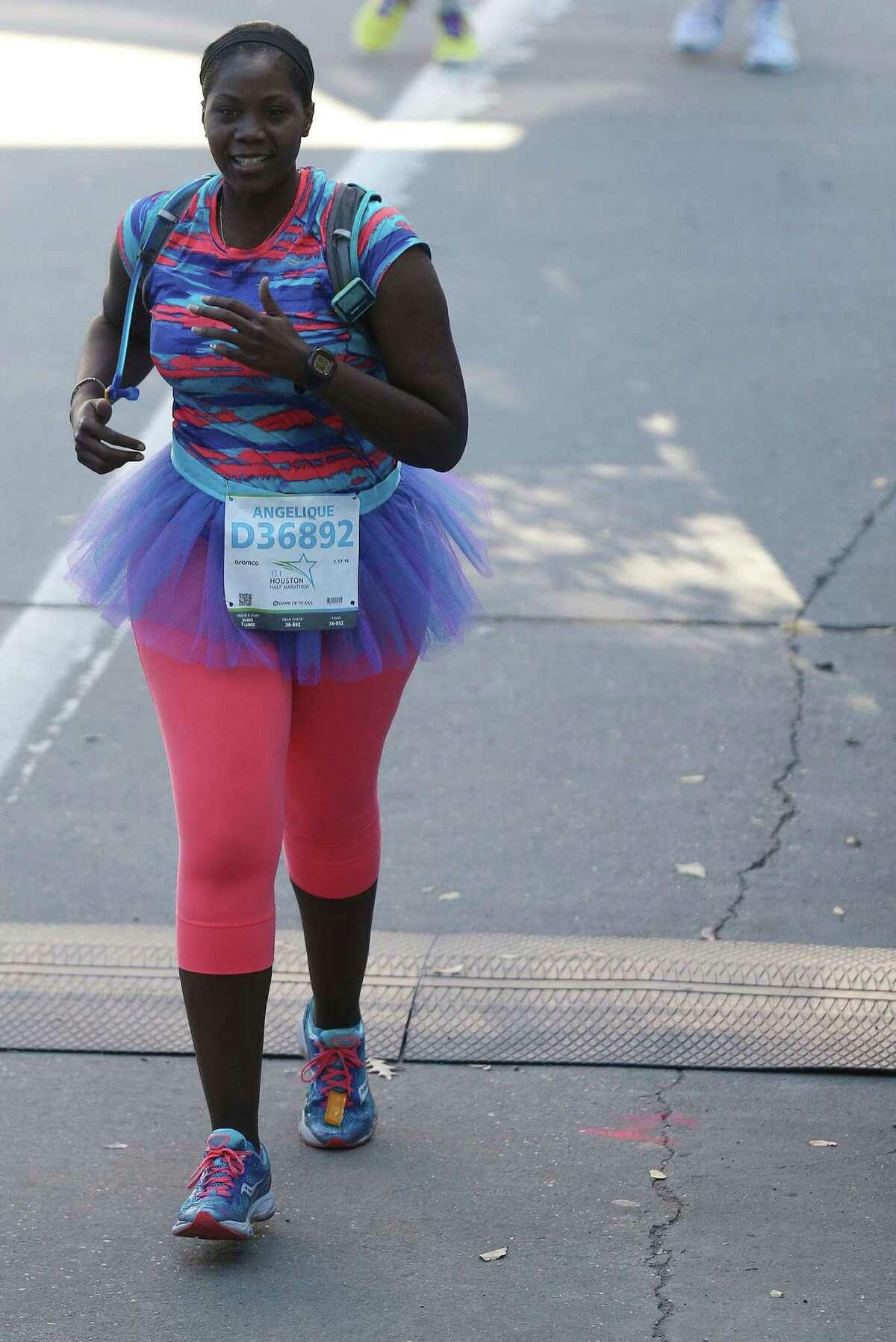 Angelique Woods wears a tutu for her half marathon run on Sunday, Jan. 17, 2016, in Houston.