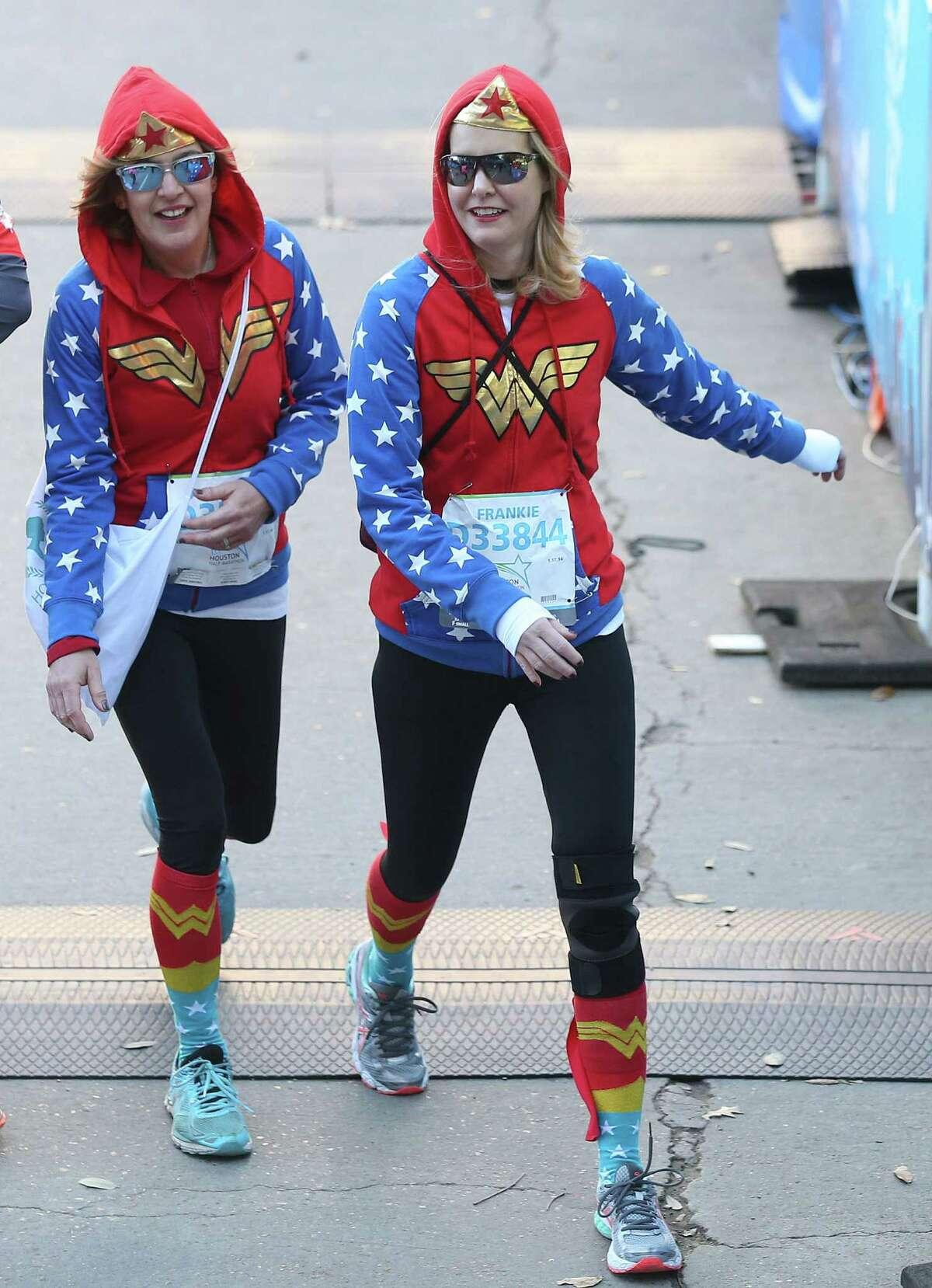 Ashley Day, left, and Frankie Cox wear wonder woman sweatshirts for the half marathon on Sunday, Jan. 17, 2016, in Houston.