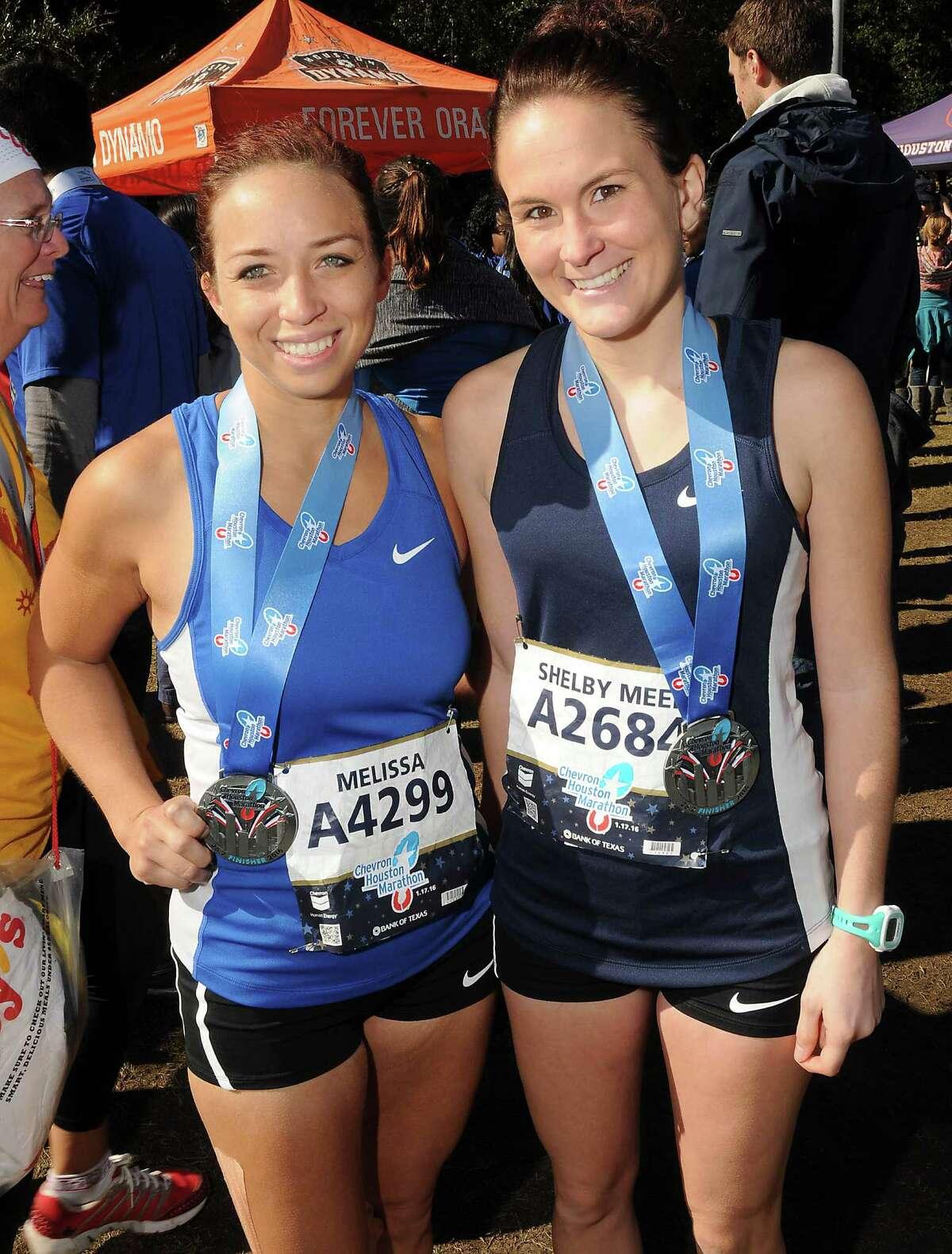 Marathon and half-marathon finishers downtown Sunday Jan. 17, 2016.(Dave Rossman photo)