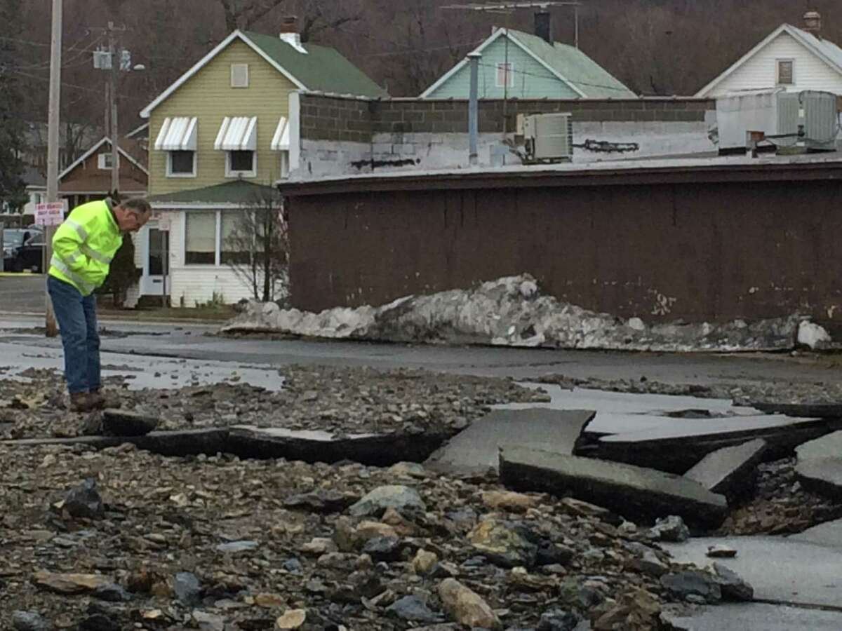 Someone on scene inspects the cater left from a water main break on Northern Drive in Lansingburgh on Sunday, Jan. 17, 2016. (Lauren Stanforth)