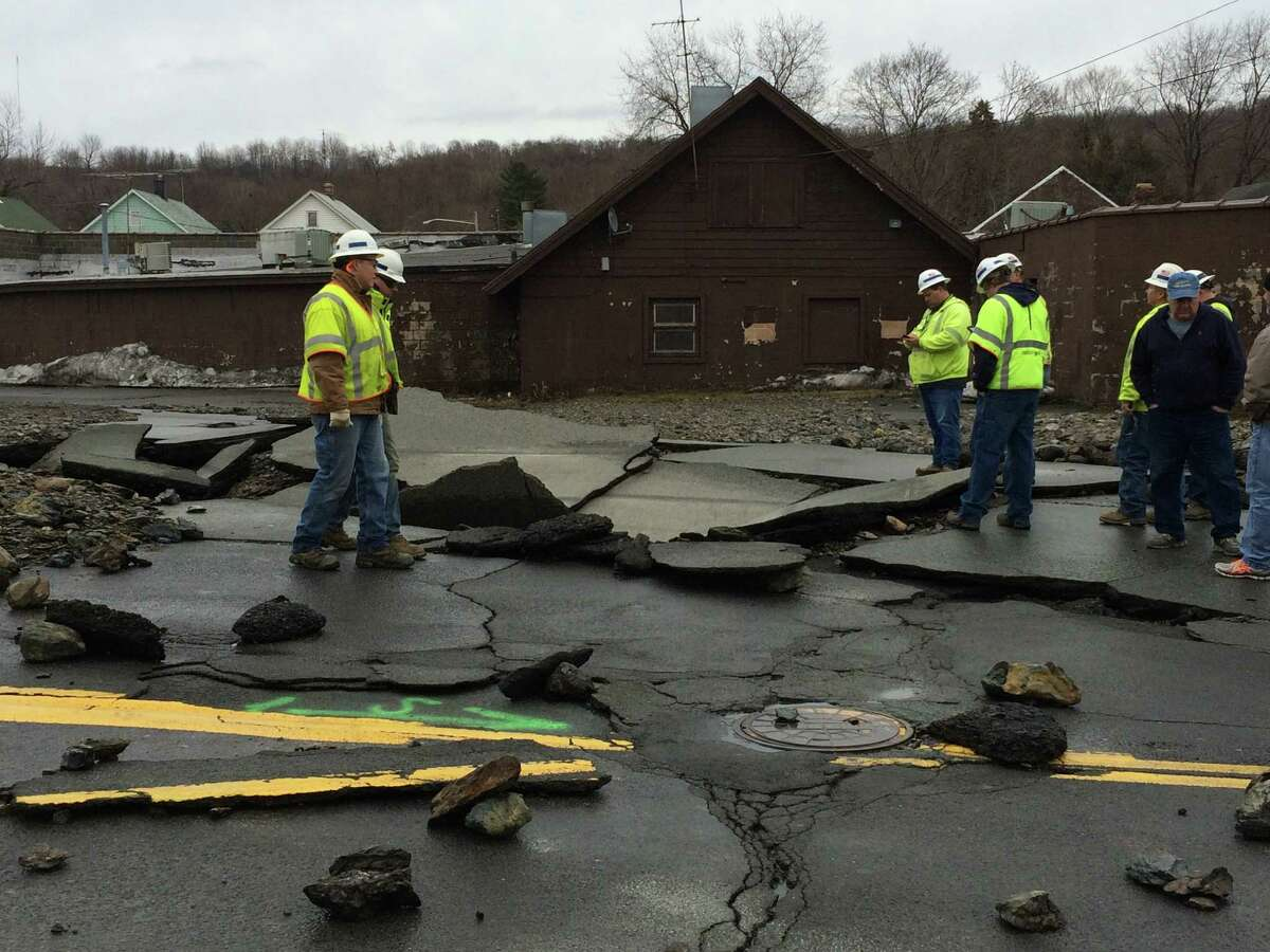 Troy Mayor Patrick Madden and Rensselaer County Executive Kathy Jimino toured the damage from a massive water main break on Northern Drive in Troy Jan. 17, 2016. (Lauren Stanforth)