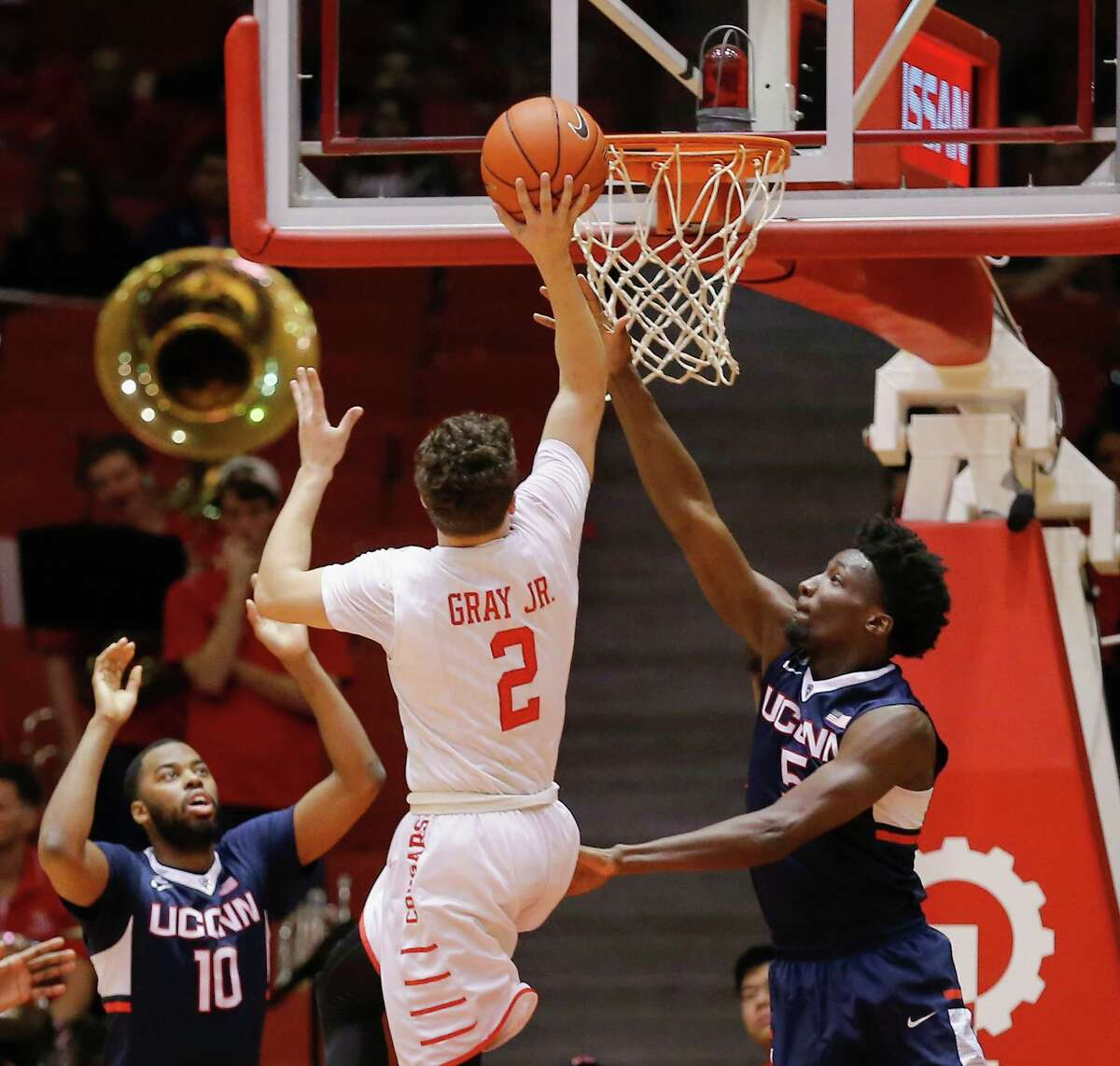 Houston guard Rob Gray Jr. (2) drives to the basket past Connecticut guard Daniel Hamilton (5) as guard Sam Cassell Jr. (10) looks on during the first half of an NCAA college basketball game Sunday, Jan. 17, 2016, in Houston. (AP Photo/Bob Levey)